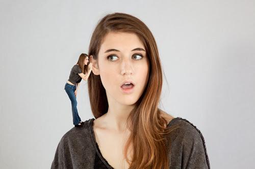 woman talking into her ear